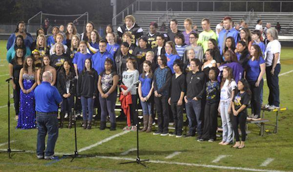 Parents, grads, and current students sing in Alumni Choir at Homecoming